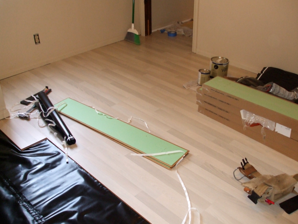Sub Floor Vapor Barrier Then Cusioned Laminate Continuted On Through Step Down
